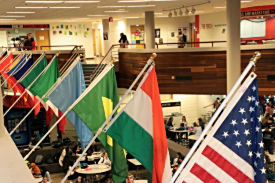 Students eat lunch beneath the uniting flags.