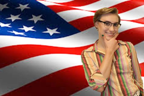 Karen Larionova looks smug in front of an American flag.