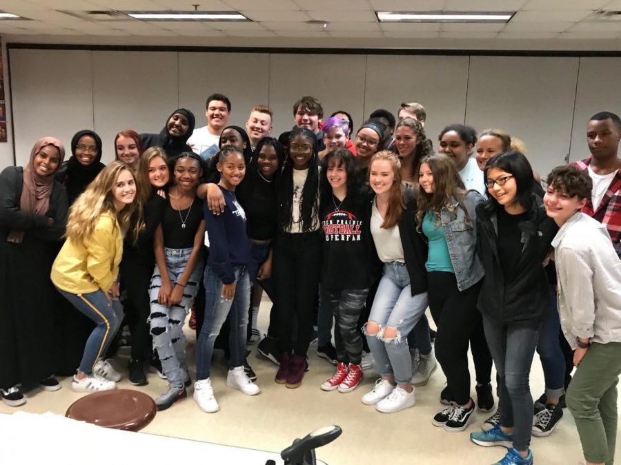 The ISJ class poses with activist Aalayah Eastmond.