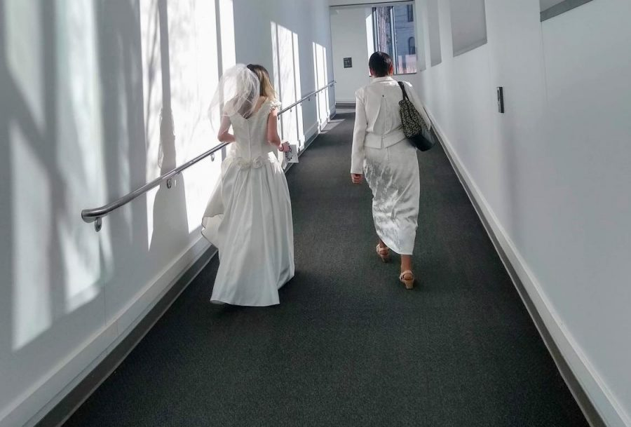 Willett (left) with Ellen Kennedy (right) walking to the child marriage press conference. Kennedy is Willett's mentor at World Without Genocide and introduced her to working on the bill.